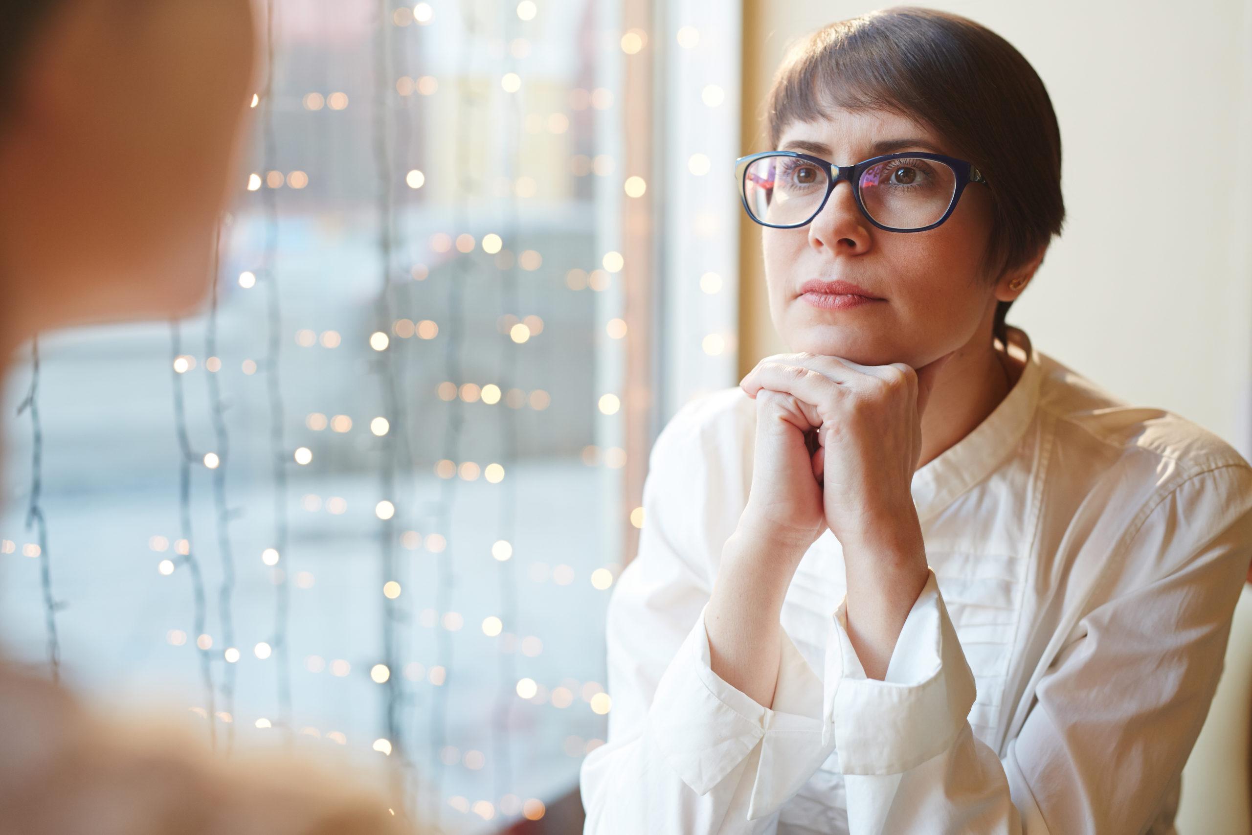 Denver MedSpa provider listening closely to patient